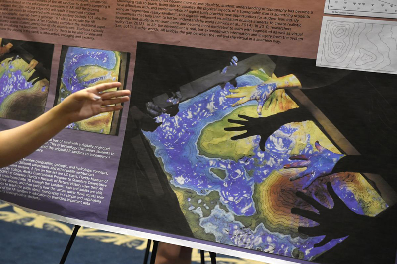 Research poster from Natalie Bursztyn lab showing augmented reality sandbox.