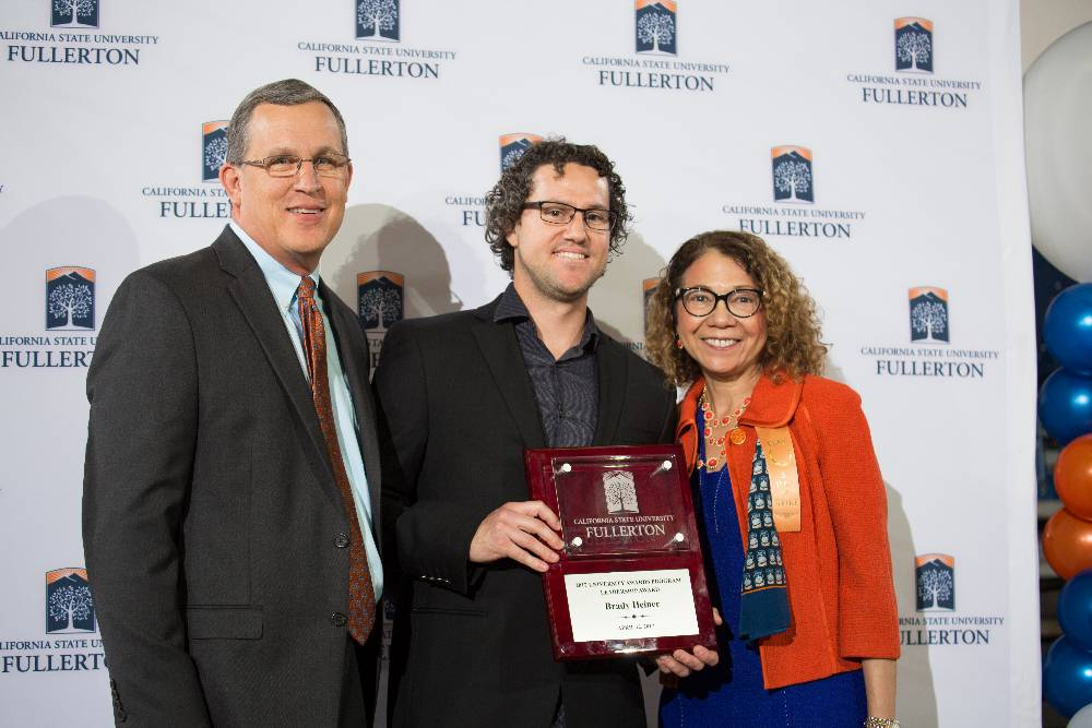 Director Brady Heiner receives Leadership Award from President Mildred Garcia