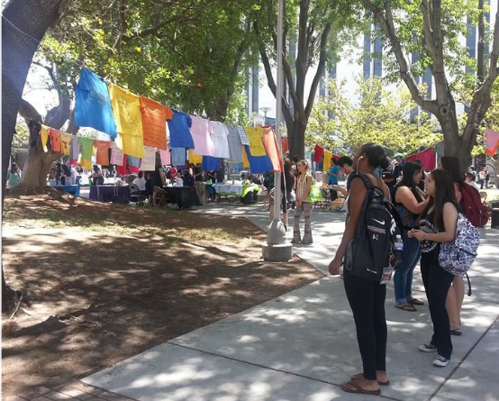 Students in the Quad view the Clothesline Project.